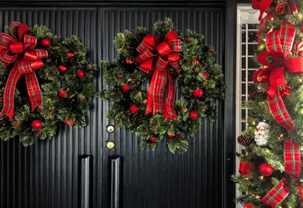 Christmas wreaths on a home's front doors