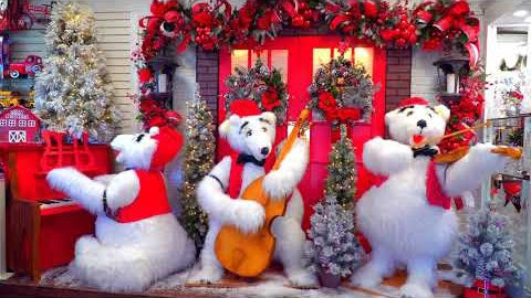 Three polar bears playing musical instruments