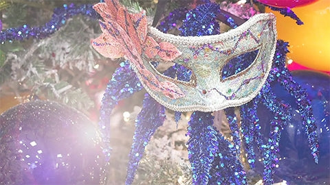 Masquerade mask ornament on a blue themed Christmas tree