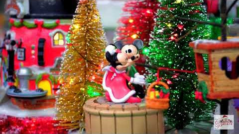 Micky Mouse and Minnie Mouse dancing in a Christmas village