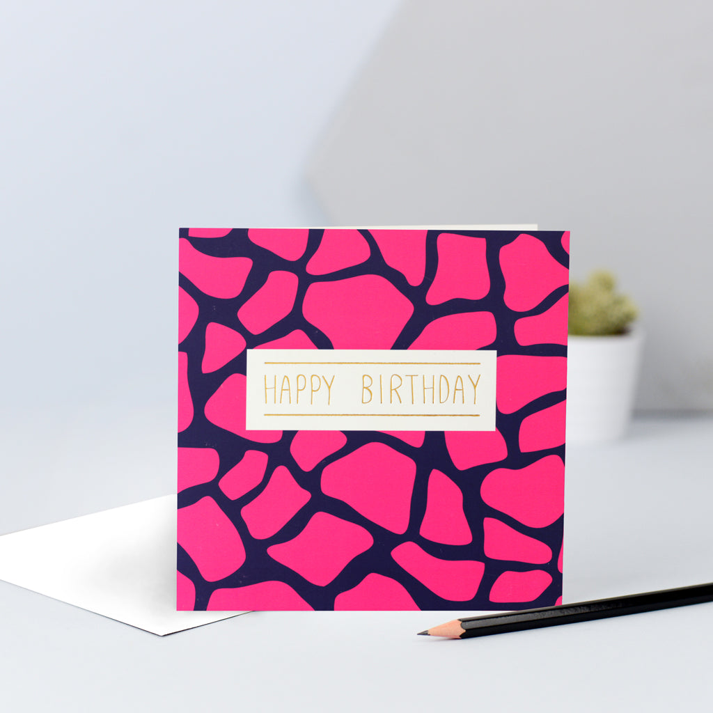 A hot pink and navy giraffe print birthday card.