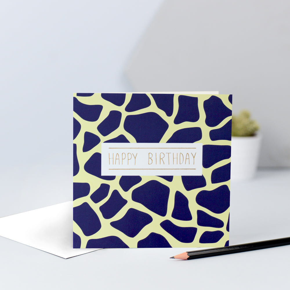 A yellow and navy giraffe print birthday card