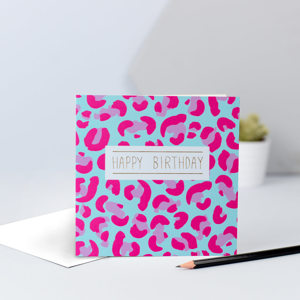 A pink and blue leopard print card
