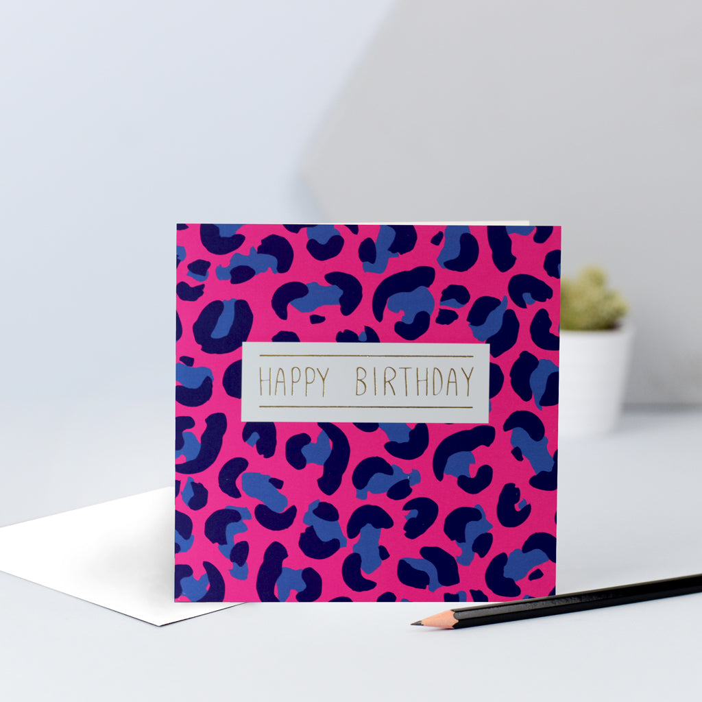 "A hot pink and blue leopard print birthday card finished with ""Happy birthday"" in gold foil."