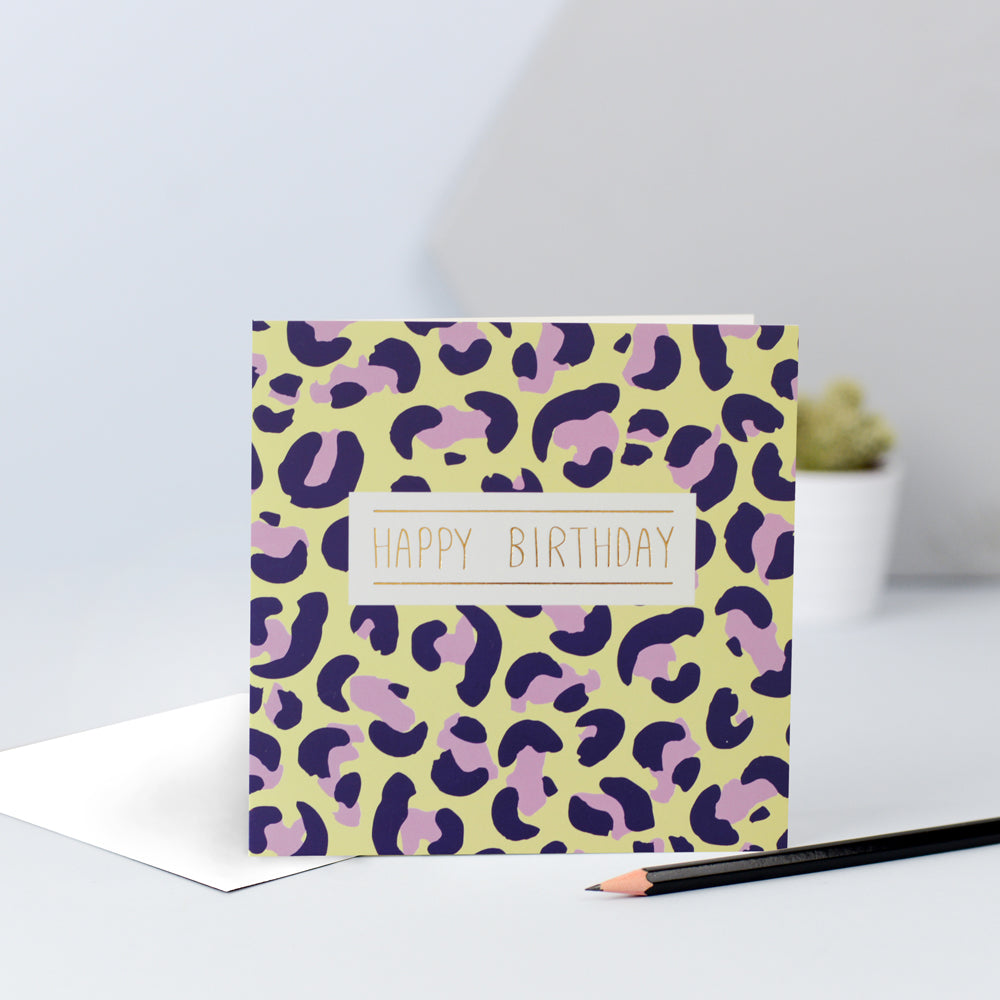 A yellow, lilac and navy leopard print birthday card
