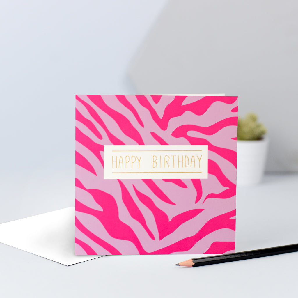A pink zebra print birthday card.