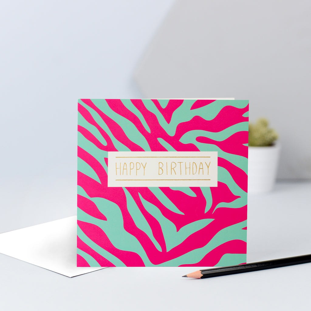A pink and green zebra print birthday card.