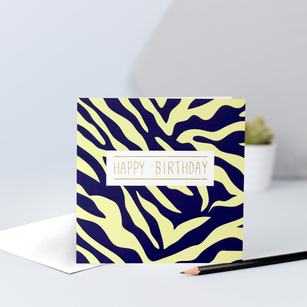 A yellow and navy zebra print birthday card