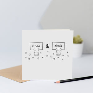 "A same sex wedding card with two ""bride"" name places"