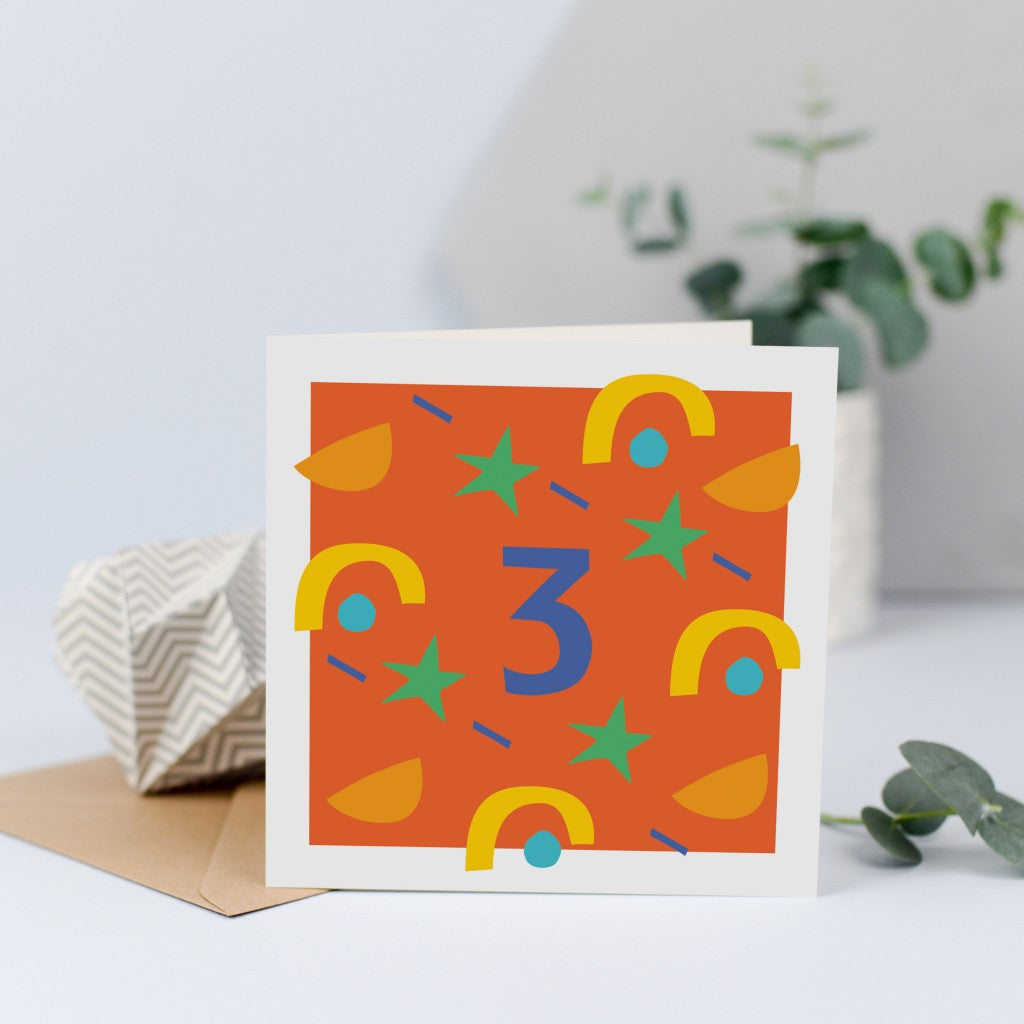 A unisex third birthday card with bright colours and shapes
