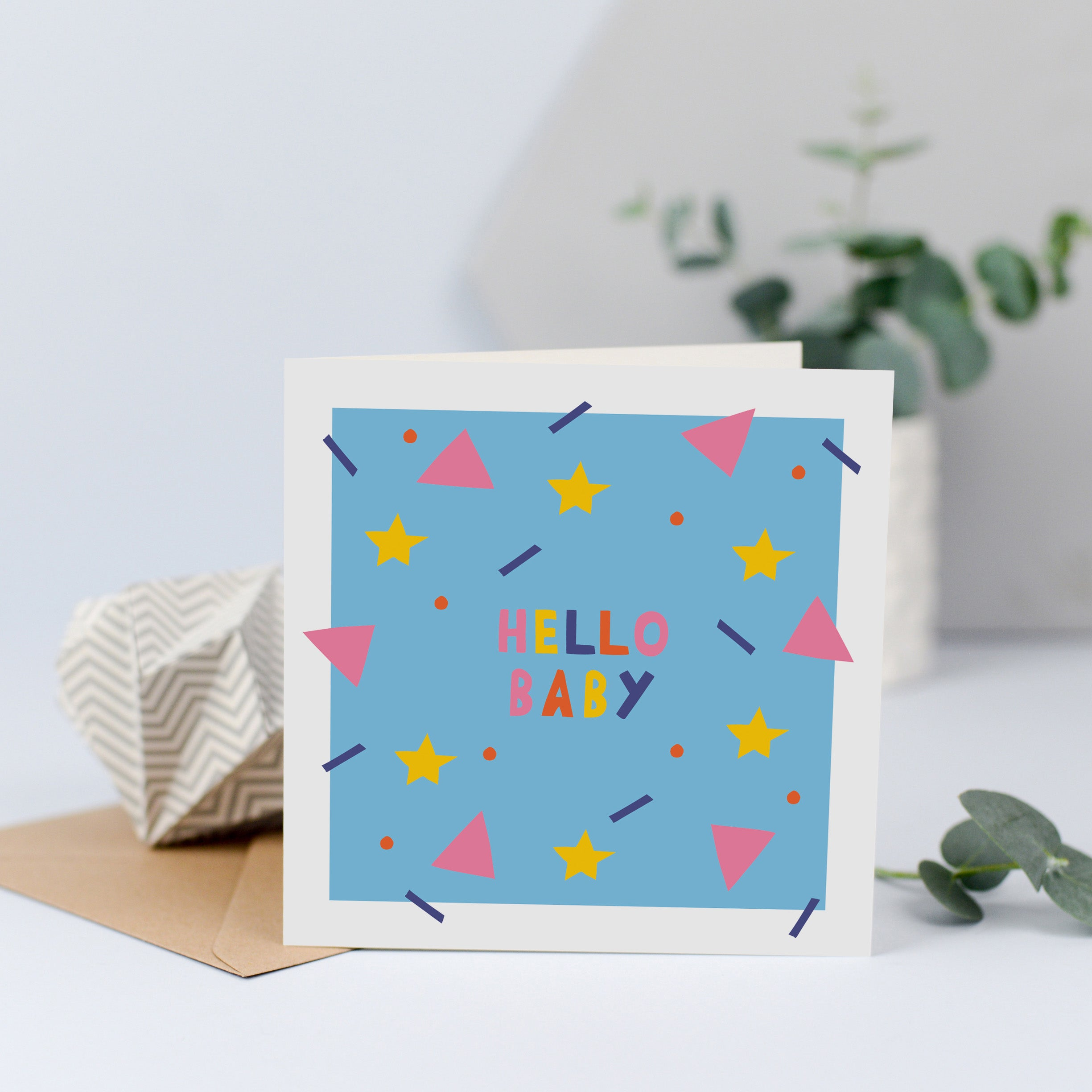 A unisex new baby card with the words hello baby