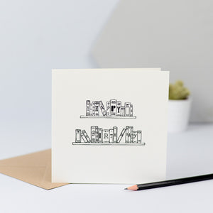 "A simple birthday books card with an illustration of some lovely old books on a shelf spelling out the words ""Happy Birthday""."