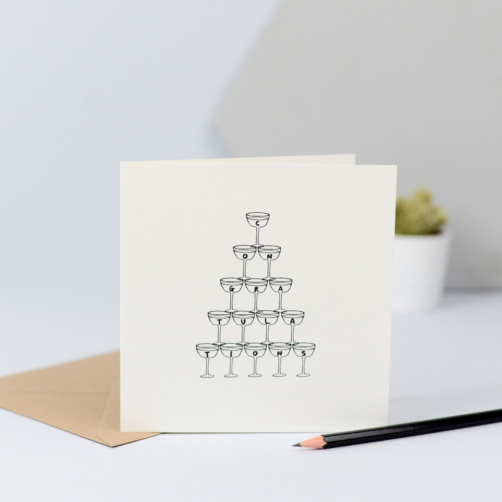 A congratulations card with an illustration of a vintage champagne glass stack.