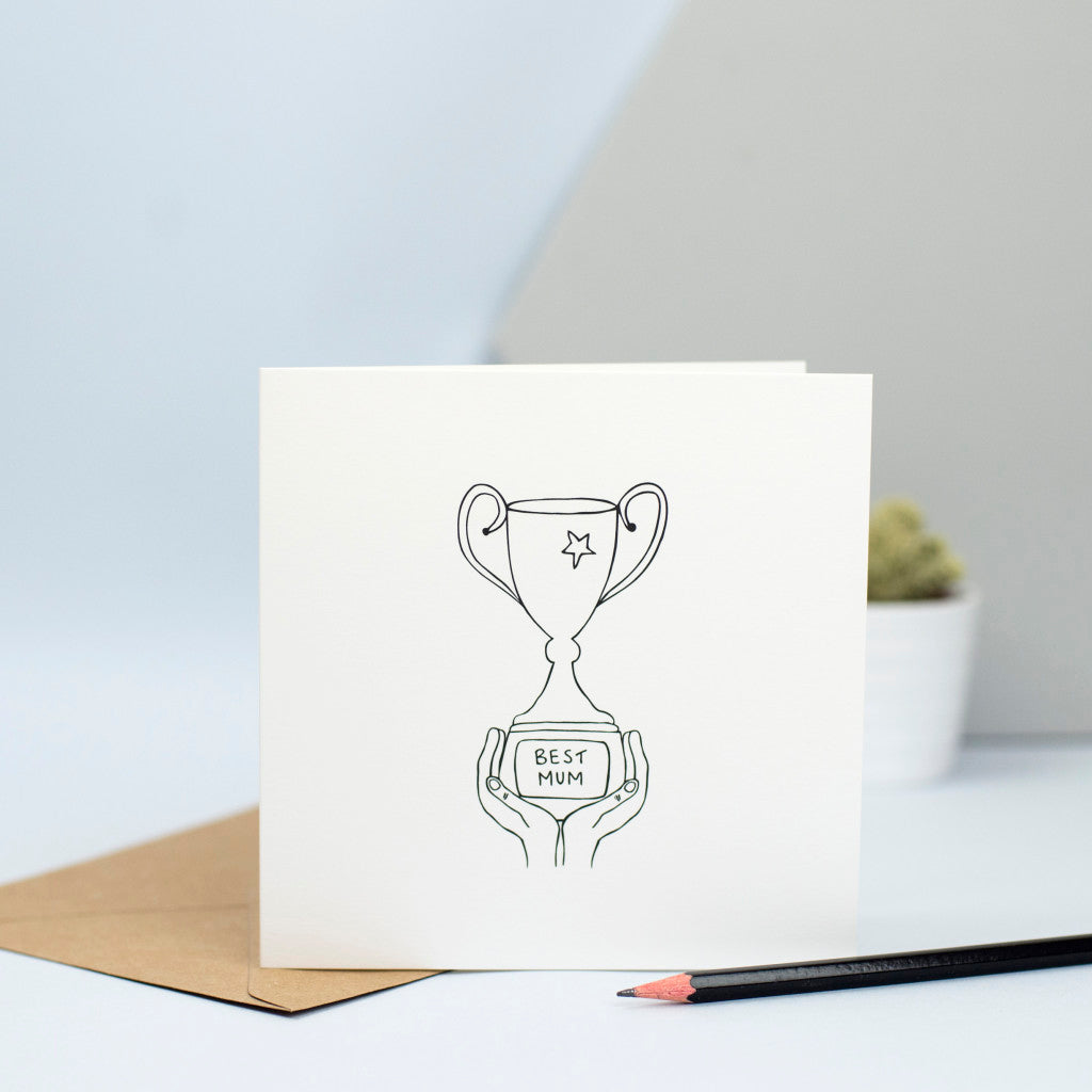 "An illustration of some hands holding a trophy with a plaque that says ""Best Mum"".  A lovely card for your mum on her birthday or for mothers' day."