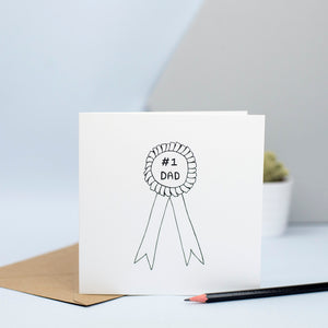 A simple illustration of a rosette with the words #1 Dad.  The perfect card for fathers day or your dad's birthday.