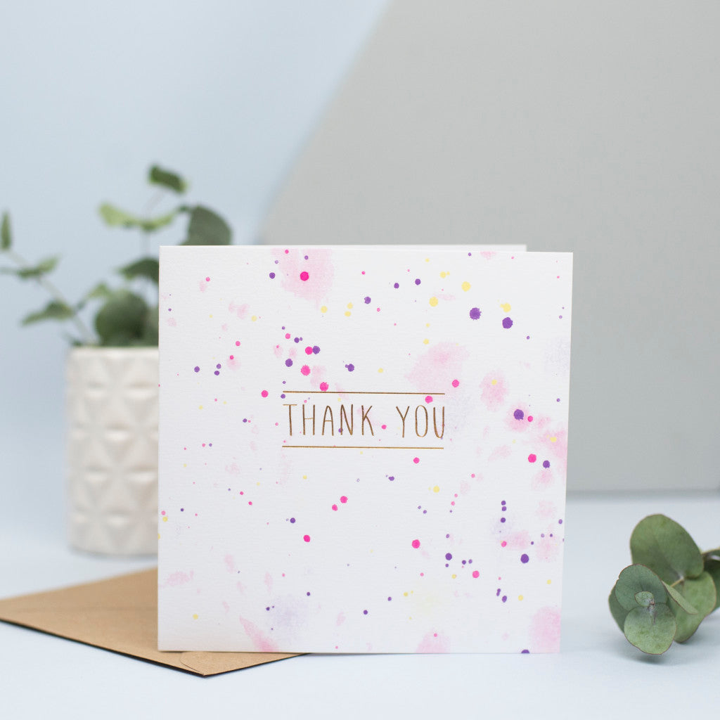 A watercolour and gold foil thank you card.