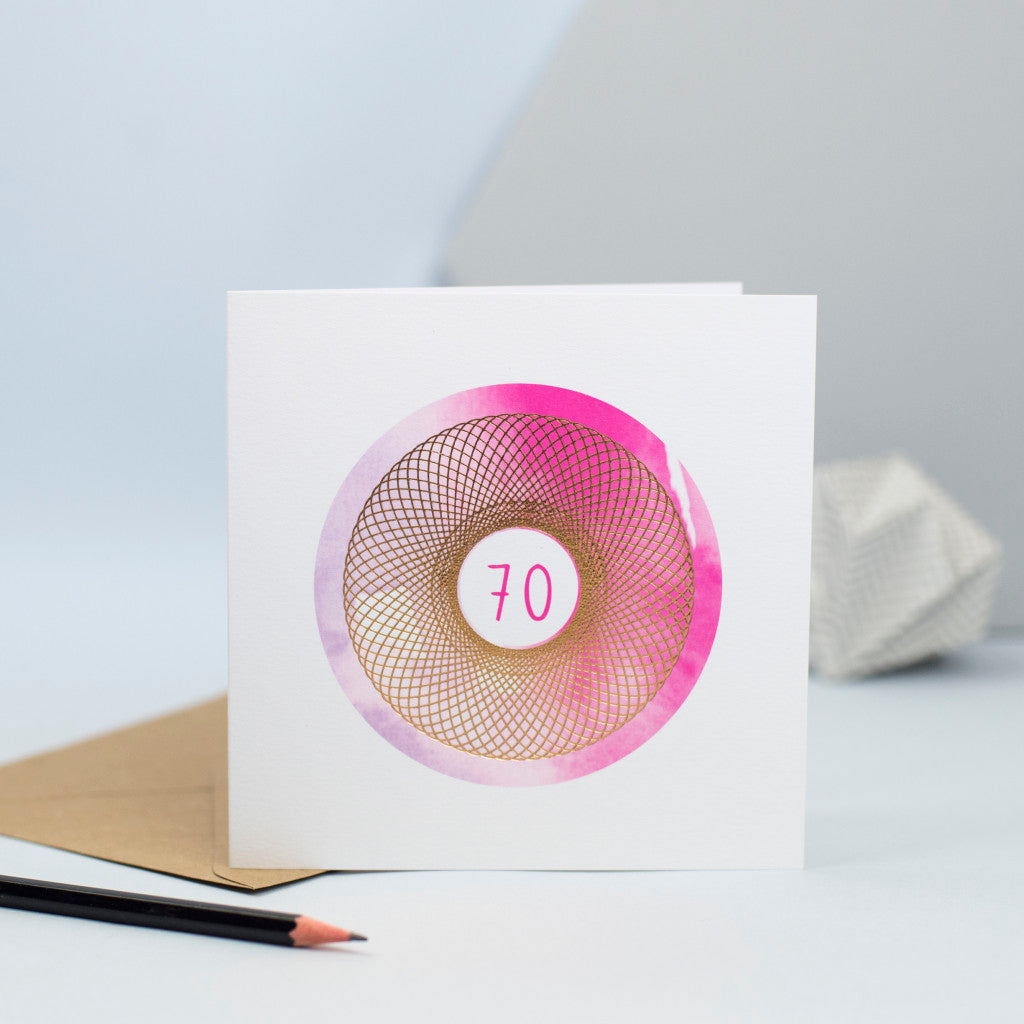 A stunning pink 70th birthday card finished with a gold foil spirograph.