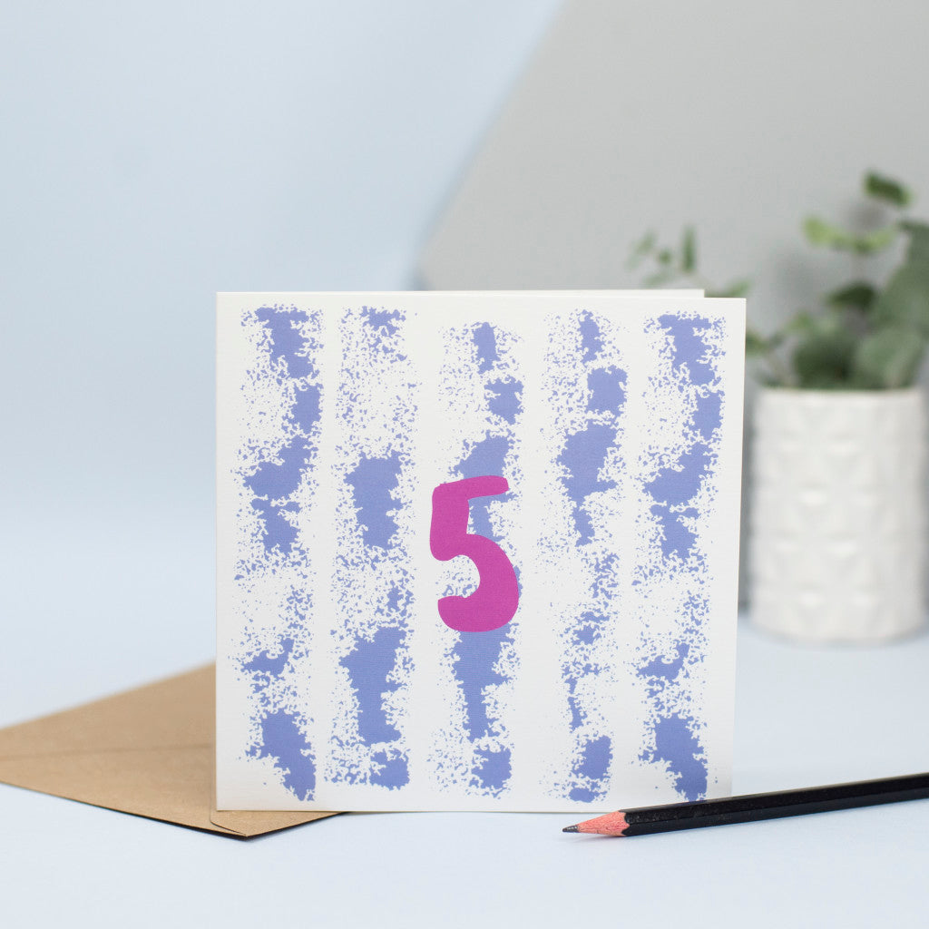 A clean and simple 5th birthday card created through mark making, with a textured roller design in blue in the background and the number 5 in maroon in the foreground.  An original design and a unisex birthday card for a 5 year old.