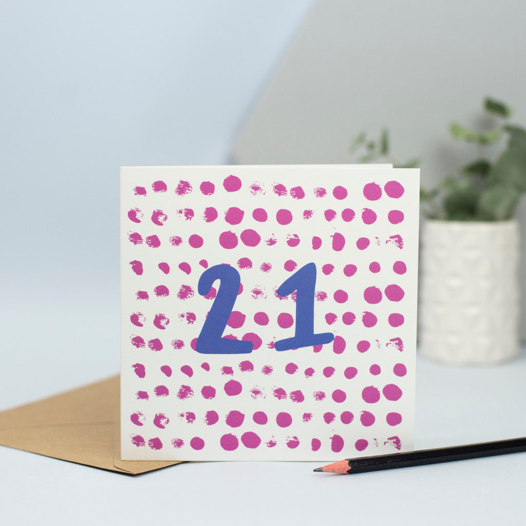 A fun, simple design for a 21st birthday. This design was made using mark making with maroon circular dots in the background and the umber 21 in blue in the foreground.