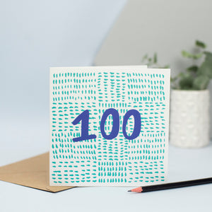 A contemporary birthday card for someone turning 100 created using mark making. A background made up of small green marks with the number 100 in the foreground in blue.
