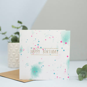 "A beautiful birthday card for any age with a watercolour background and the words ""Happy birthday"" in gold foil."