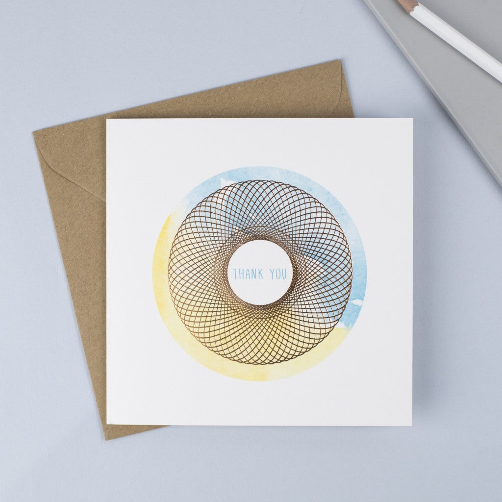 Copper foiled Spirograph with a watercolour background and hand drawn font