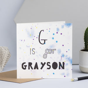 A close up of the blue design with the words G is for Grayson