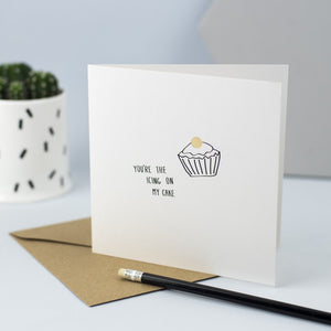 "Hand drawn illustration of a cupcake with gold foil and the words ""You're the icing on my cake"""