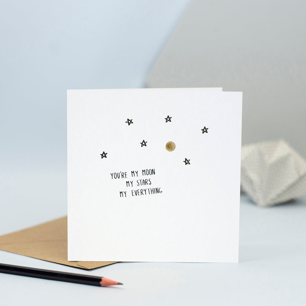 "A simple design of a moon and stars With the words ""You're my moon my stars my everything"""