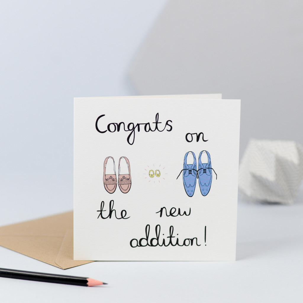 A new baby card with an illustration of three pairs of shoes.