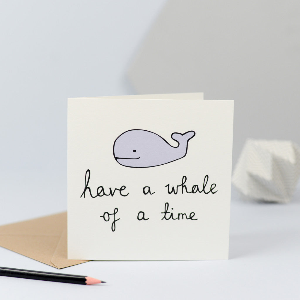 "An illustration of a whale with the words ""Have a whale of a time""."