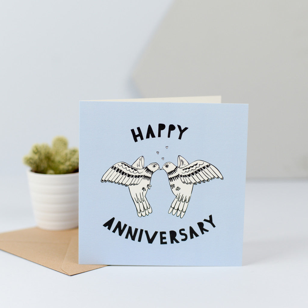 A lovely anniversary card with an illustration of two doves sharing a kiss.