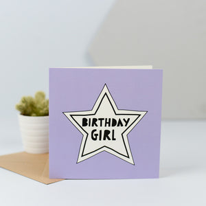 "A simple but fun birthday card for the birthday girl with a white star on a purple background and the words ""Birthday Girl"" in the centre of the star."