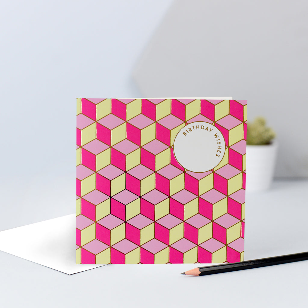 "A fun tessellating pattern with pinks and yellows, finished with gold foil and the words ""Birthday Wishes""."