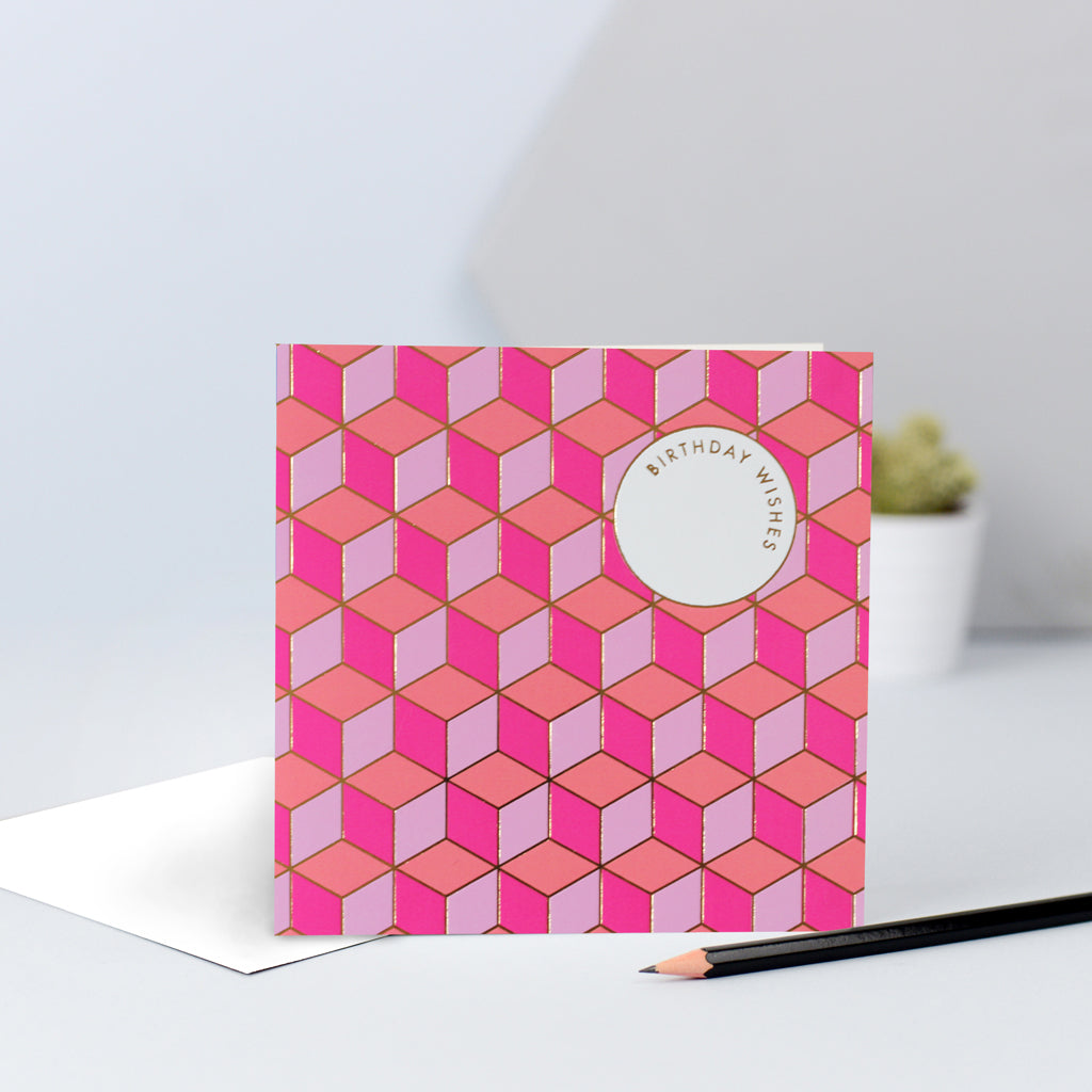 "A fun tessellating pattern with pinks and orange, finished with gold foil and the words ""Birthday Wishes""."
