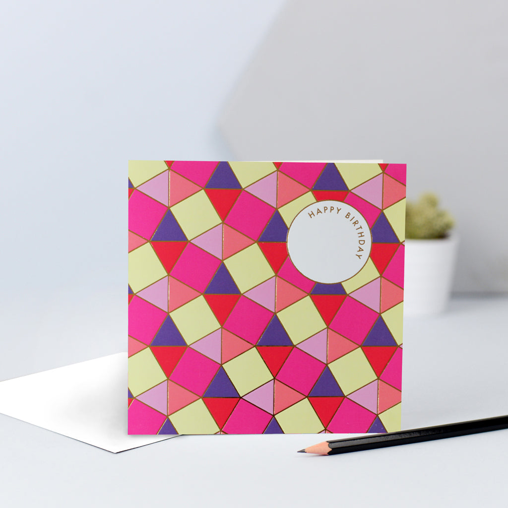 A pink, red purple and yellow tessellating birthday card with gold foil