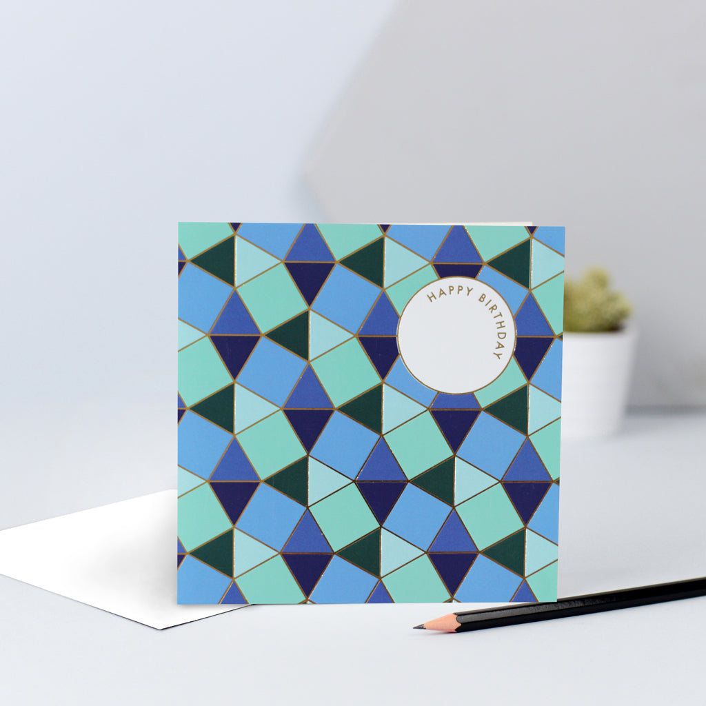 A blue and green tessellating birthday card with gold foil