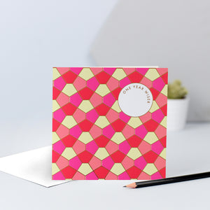 A pink, yellow, red and peach tessellating birthday card