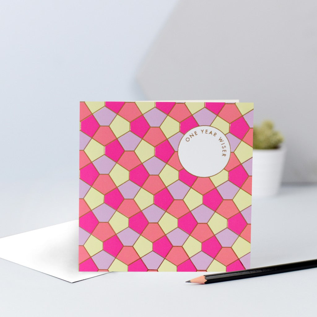 A lilac, yellow, orange & pink tessellating birthday card with a gold foil finish.