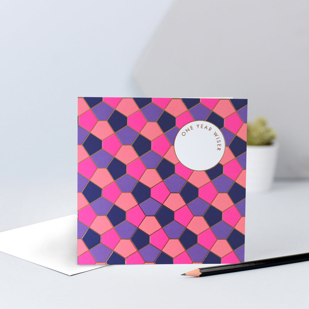 A purple, orange, navy & pink tessellating birthday card design