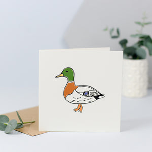 A card with an illustration of a duck.