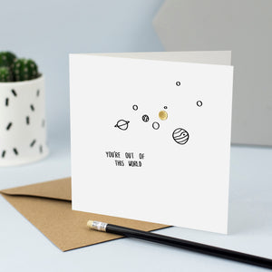 "Hand drawn illustration of the solar system with gold foil and the words ""You're out of this world"""