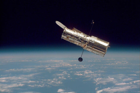 Hubble space telescope in orbit over earth