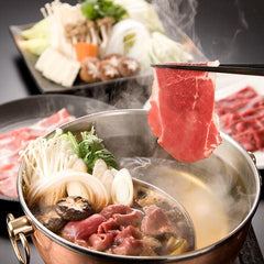 Traditional Japanese Hot Pot: Similar to sukiyaki, shabu-shabu is a nabe dish that involves thin slices of beef (or sometimes pork) being briefly cooked in a simmering broth