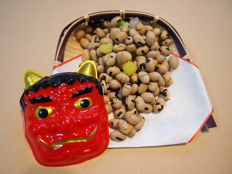 "On February 3, people across Japan engage in the ritual of mamemaki (豆撒き | ""bean scattering) in which evil from the previous year is driven away by throwing fukumame (福豆) ""lucky"" roasted soybeans out the door. Alternatively, some may even throw them at a person symbolizing evil spirits by wearing the mask of an Oni (鬼 