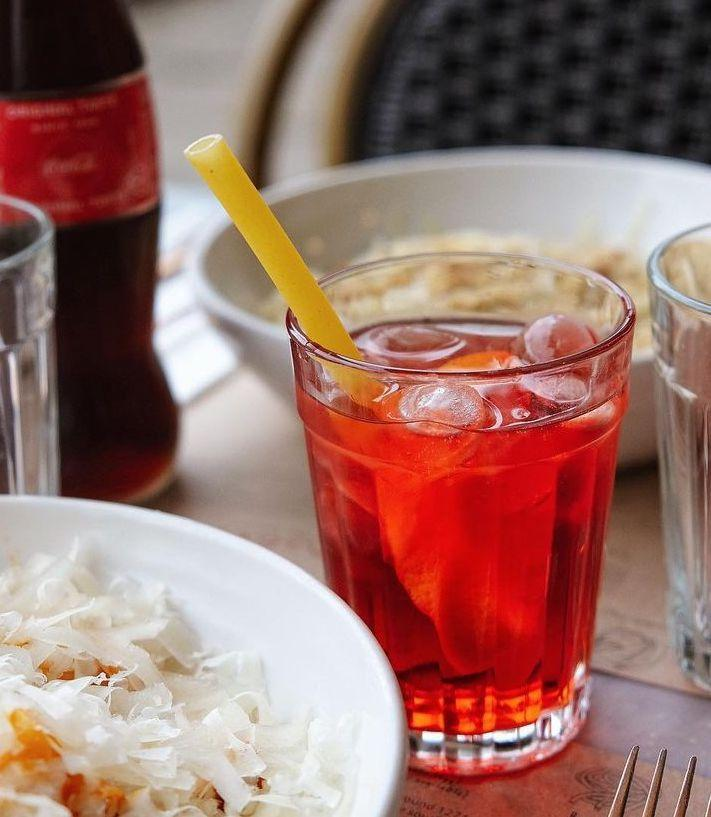 Image of a Negroni with a stroodle pasta straw