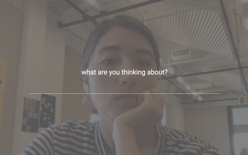 "A screenshot of the Glance Back extension, featuring an image of the user looking at themselves with a question on the screen that prompts an answer: ""what are you thinking about?"""