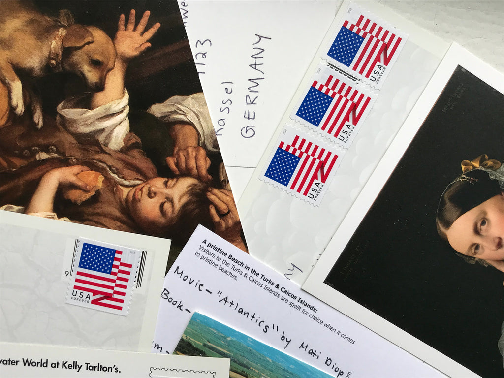 An image of an array of postcards and envelopes overlapping one another.