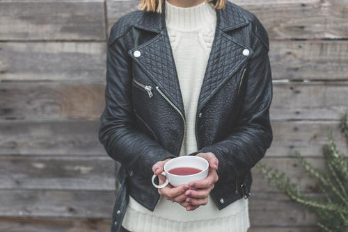 woman wearing classic biker-style leather jacket