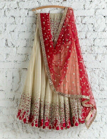 Classic Cream Color Embroidered Semi-stitched Lehenga Choli